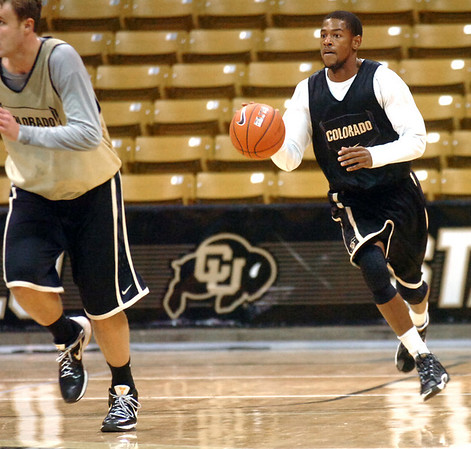 "#11 Cory Higgins drives down the court during the University of Colorado Men's basketball team practice Tuesday morning October 19, 2010 at the Coors Events Center on the CU Boulder Campus. FOR MORE PHOTOS GO TO  <a href=""http://WWW.DAILYCAMERA.COM"">http://WWW.DAILYCAMERA.COM</a>"