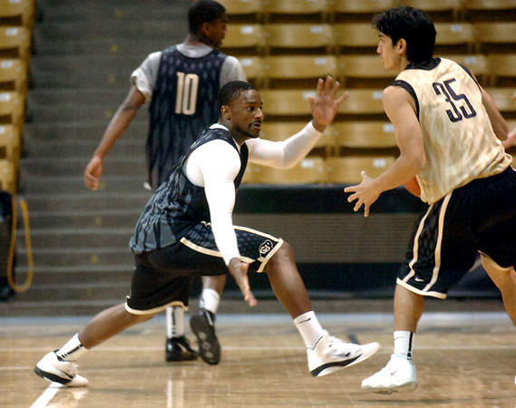 """#2 Shannon Sharpe guards against #35 Hassan Safieddine during the University of Colorado Men's basketball team practice Tuesday morning October 19, 2010 at the Coors Events Center on the CU Boulder Campus. FOR MORE PHOTOS GO TO  <a href=""""http://WWW.DAILYCAMERA.COM"""">http://WWW.DAILYCAMERA.COM</a>"""