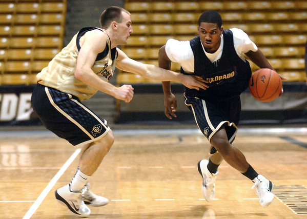 """#24 Levi Knutson, left, guards, #14 Javon Coney during the University of Colorado Men's basketball team practice Tuesday morning October 19, 2010 at the Coors Events Center on the CU Boulder Campus. FOR MORE PHOTOS GO TO  <a href=""""http://WWW.DAILYCAMERA.COM"""">http://WWW.DAILYCAMERA.COM</a>"""