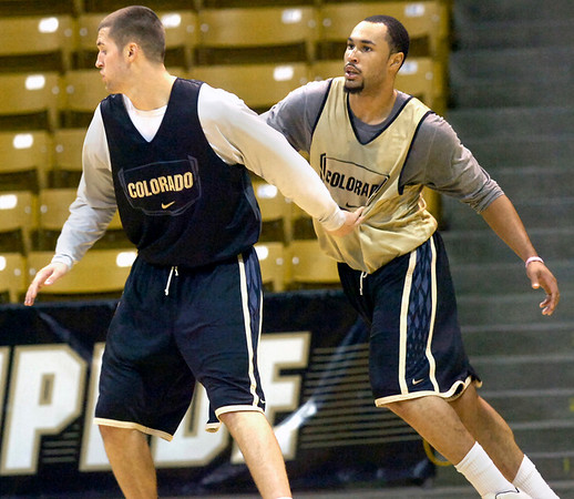 "#33 Austin Dufault, left  battles for position with #5 Marcus Relphorde during the University of Colorado Men's basketball team practice Tuesday morning October 19, 2010 at the Coors Events Center on the CU Boulder Campus. FOR MORE PHOTOS GO TO  <a href=""http://WWW.DAILYCAMERA.COM"">http://WWW.DAILYCAMERA.COM</a>"