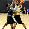 """University of Colorado's Shannon Sharpe, left, tries to block a pass from Carlon Brown on Friday, Oct. 14, during the first CU Men's basketball practice at the Coors Event Center on the CU campus in Boulder. For more photos of the practice go to  <a href=""""http://www.dailycamera.com"""">http://www.dailycamera.com</a><br /> Jeremy Papasso/ Camera"""