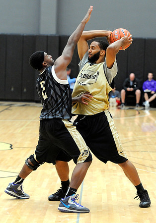 "University of Colorado's Shannon Sharpe, left, tries to block a pass from Carlon Brown on Friday, Oct. 14, during the first CU Men's basketball practice at the Coors Event Center on the CU campus in Boulder. For more photos of the practice go to  <a href=""http://www.dailycamera.com"">http://www.dailycamera.com</a><br /> Jeremy Papasso/ Camera"