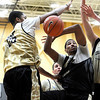 """University of Colorado sophomore Andre Roberson gets his shot blocked by freshman Spencer Dinwiddie, left, and sophomore Ben Mills, on Friday, Oct. 14, during the first CU Men's basketball practice at the Coors Event Center on the CU campus in Boulder. For more photos of the practice go to  <a href=""""http://www.dailycamera.com"""">http://www.dailycamera.com</a><br /> Jeremy Papasso/ Camera"""