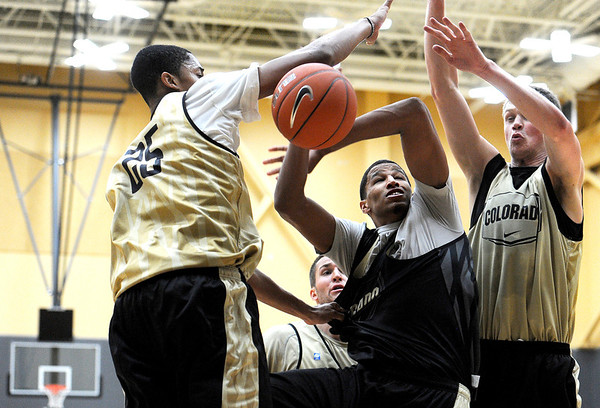 "University of Colorado sophomore Andre Roberson gets his shot blocked by freshman Spencer Dinwiddie, left, and sophomore Ben Mills, on Friday, Oct. 14, during the first CU Men's basketball practice at the Coors Event Center on the CU campus in Boulder. For more photos of the practice go to  <a href=""http://www.dailycamera.com"">http://www.dailycamera.com</a><br /> Jeremy Papasso/ Camera"