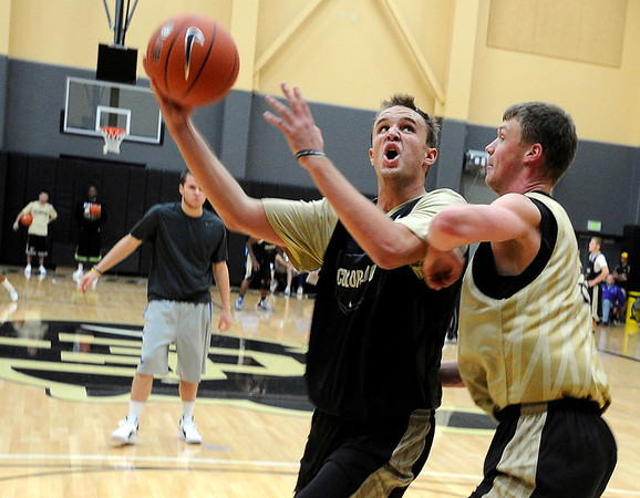 "University of Colorado senior Trey Eckloff goes for a layup over sophomore Ben Mills on Friday, Oct. 14, during the first CU Men's basketball practice at the Coors Event Center on the CU campus in Boulder. For more photos of the practice go to  <a href=""http://www.dailycamera.com"">http://www.dailycamera.com</a><br /> Jeremy Papasso/ Camera"