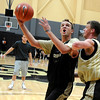 """University of Colorado senior Trey Eckloff goes for a layup over sophomore Ben Mills on Friday, Oct. 14, during the first CU Men's basketball practice at the Coors Event Center on the CU campus in Boulder. For more photos of the practice go to  <a href=""""http://www.dailycamera.com"""">http://www.dailycamera.com</a><br /> Jeremy Papasso/ Camera"""