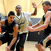 """University of Colorado freshman Askia Booker drives towards the hoop on Friday, Oct. 14, during the first CU Men's basketball practice at the Coors Event Center on the CU campus in Boulder. For more photos of the practice go to  <a href=""""http://www.dailycamera.com"""">http://www.dailycamera.com</a><br /> Jeremy Papasso/ Camera"""