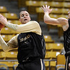 "Austin Dufault, left, and Levi Knutson during CU practice on Friday.<br /> The University of Colorado's men's basketball team is preparing for the NIT Final 4 in New York.  For videos of players and coach Boyle, go to  <a href=""http://www.dailycamera.com"">http://www.dailycamera.com</a>.<br /> Cliff Grassmick/ March 25, 2011"