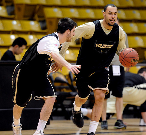 """Marcus Relphorde dribbles around Nate Tomlinson during practice on Friday.<br /> The University of Colorado's men's basketball team is preparing for the NIT Final 4 in New York.  For videos of players and coach Boyle, go to  <a href=""""http://www.dailycamera.com"""">http://www.dailycamera.com</a>.<br /> Cliff Grassmick/ March 25, 2011"""