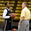 "Cory Higgins talks with Tad Boyle on Friday.<br /> The University of Colorado's men's basketball team is preparing for the NIT Final 4 in New York.  For videos of players and coach Boyle, go to  <a href=""http://www.dailycamera.com"">http://www.dailycamera.com</a>.<br /> Cliff Grassmick/ March 25, 2011"