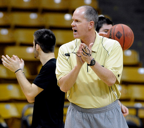"""Colorado head coach, Tad Boyle, works practice on Friday, March 25, 2011.<br /> The University of Colorado's men's basketball team is preparing for the NIT Final 4 in New York.  For videos of players and coach Boyle, go to  <a href=""""http://www.dailycamera.com"""">http://www.dailycamera.com</a>.<br /> Cliff Grassmick/ March 25, 2011"""