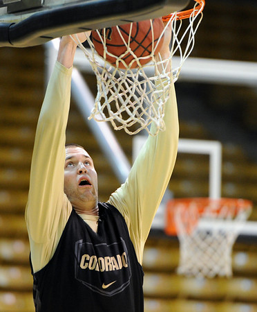 "Austin Dufault shoots at CU practice on Friday.<br /> The University of Colorado's men's basketball team is preparing for the NIT Final 4 in New York.  For videos of players and coach Boyle, go to  <a href=""http://www.dailycamera.com"">http://www.dailycamera.com</a>.<br /> Cliff Grassmick/ March 25, 2011"