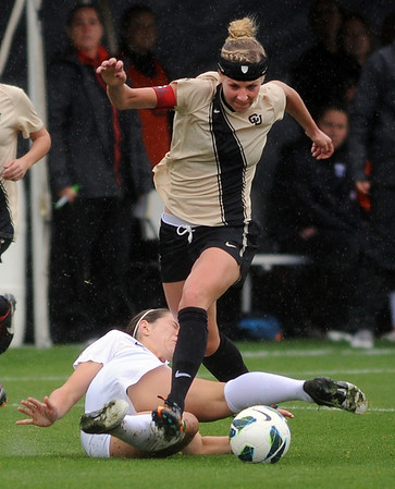 """Amy Barczuk, right, of CU, runs over Erin Uchacz of Oregon State on Saturday.<br /> For more photos from the game, go to  <a href=""""http://www.dailycamera.com"""">http://www.dailycamera.com</a>.<br /> Cliff Grassmick  / October 13, 2012"""