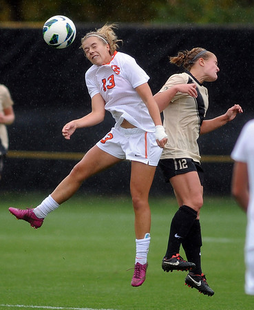 "Jacy Drobney, left, of OSU, and Carly Bolyard of CU, go up on a header in the rain.<br /> For more photos from the game, go to  <a href=""http://www.dailycamera.com"">http://www.dailycamera.com</a>.<br /> Cliff Grassmick  / October 13, 2012"