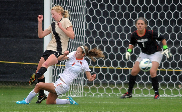 "Lizzy Herzl, left, of CU, and Brandi Dawson of OSU, collide after hitting the ball near CU's goal.<br /> For more photos from the game, go to  <a href=""http://www.dailycamera.com"">http://www.dailycamera.com</a>.<br /> Cliff Grassmick  / October 13, 2012"