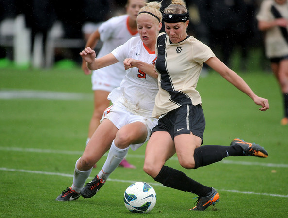 "Amy Barczuk, right, of CU, takes a shot  past Gwen Bieck of Oregon State on Saturday.<br /> For more photos from the game, go to  <a href=""http://www.dailycamera.com"">http://www.dailycamera.com</a>.<br /> Cliff Grassmick  / October 13, 2012"