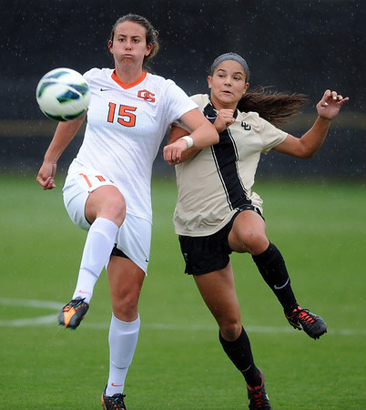 """Justyne Freud (15) of OSU, and Olivia Pappalardo of CU, battle for possession on Saturday.<br /> For more photos from the game, go to  <a href=""""http://www.dailycamera.com"""">http://www.dailycamera.com</a>.<br /> Cliff Grassmick  / October 13, 2012"""