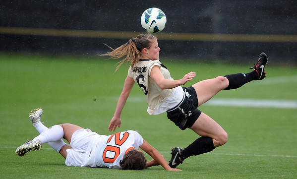 """Hayley Hughes, right, of CU, goes to the ball past Brittany Oljar of Oregon State on Saturday.<br /> For more photos from the game, go to  <a href=""""http://www.dailycamera.com"""">http://www.dailycamera.com</a>.<br /> Cliff Grassmick  / October 13, 2012"""