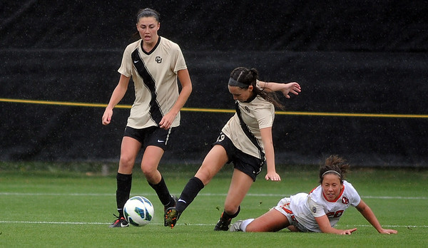 "Darcy Jerman of CU kicks the ball down field past Brittney Oljaf.<br /> For more photos from the game, go to  <a href=""http://www.dailycamera.com"">http://www.dailycamera.com</a>.<br /> Cliff Grassmick  / October 13, 2012"