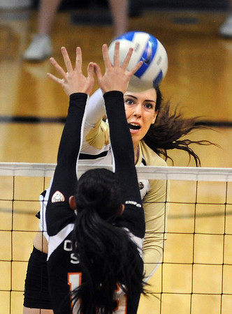 """Kelsey English of CU, gets a shot past Amanda Brown of Oregon State.<br /> For more photos of the game, go to  <a href=""""http://www.dailycamera.com"""">http://www.dailycamera.com</a>.<br /> Cliff Grassmick / October 28, 2012"""