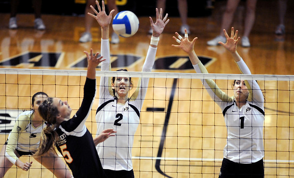 """Ana Pantovic (2) and Kelsey English, both of CU, go up to block the shot of Sara Almen of Oregon State.<br /> For more photos of the game, go to  <a href=""""http://www.dailycamera.com"""">http://www.dailycamera.com</a>.<br /> Cliff Grassmick / October 28, 2012"""