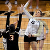 "Nikki Lindow of CU hits past Camille Saxton of Oregon State.<br /> For more photos of the game, go to  <a href=""http://www.dailycamera.com"">http://www.dailycamera.com</a>.<br /> Cliff Grassmick / October 28, 2012"
