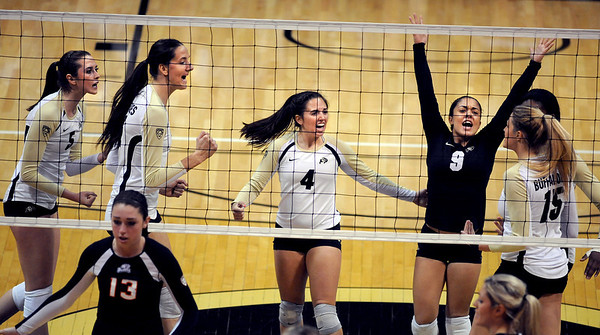 "Nicole Edelman, left, Ana Pantovic, Elysse Richardson, Chelsey Keoho and Nikki Lindow, all of CU, celebrate a point against Oregon State<br /> For more photos of the game, go to  <a href=""http://www.dailycamera.com"">http://www.dailycamera.com</a>.<br /> Cliff Grassmick / October 28, 2012"
