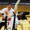 "Alexis Austin of CU hits past Megan McBride (10) of Oregon State.<br /> For more photos of the game, go to  <a href=""http://www.dailycamera.com"">http://www.dailycamera.com</a>.<br /> Cliff Grassmick / October 28, 2012"