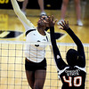 "Alexis Austin of CU hits past Arica Nassar of Oregon State.<br /> For more photos of the game, go to  <a href=""http://www.dailycamera.com"">http://www.dailycamera.com</a>.<br /> Cliff Grassmick / October 28, 2012"