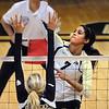 "Neira Ortiz Ruiz of CU hits past Megan McBride (10) of Oregon State.<br /> For more photos of the game, go to  <a href=""http://www.dailycamera.com"">http://www.dailycamera.com</a>.<br /> Cliff Grassmick / October 28, 2012"