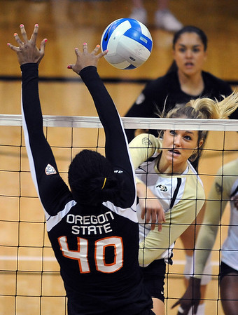 "Nikki Lindow of CU hits past Arica Nassar of Oregon State.<br /> For more photos of the game, go to  <a href=""http://www.dailycamera.com"">http://www.dailycamera.com</a>.<br /> Cliff Grassmick / October 28, 2012"