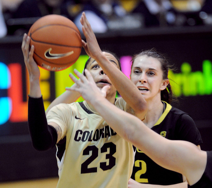 "Chucky Jeffery of CU drives past Danielle Love of Oregon.<br /> For more photos of the game, go to  <a href=""http://www.dailycamera.com"">http://www.dailycamera.com</a>.<br /> Cliff Grassmick / February 10, 2013"