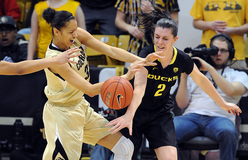 "Arielle Roberson of CU and Danielle Love of Oregon battle for a rebound.<br /> For more photos of the game, go to  <a href=""http://www.dailycamera.com"">http://www.dailycamera.com</a>.<br /> Cliff Grassmick / February 10, 2013"