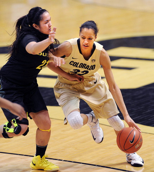 "Arielle Roberson of Colorado drives on Amanda Delgado of Oregon.<br /> For more photos of the game, go to  <a href=""http://www.dailycamera.com"">http://www.dailycamera.com</a>.<br /> Cliff Grassmick / February 10, 2013"