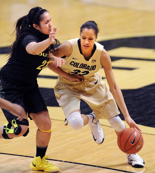 "Arielle Roberson of Colorado drives on Amanda Delgado of Oregon.<br /> For more photos of the game, go to  <a href=""http://www.dailycamera.com"">http://www.dailycamera.com</a>.<br /> Cliff Grassmick / February 10, 2013"