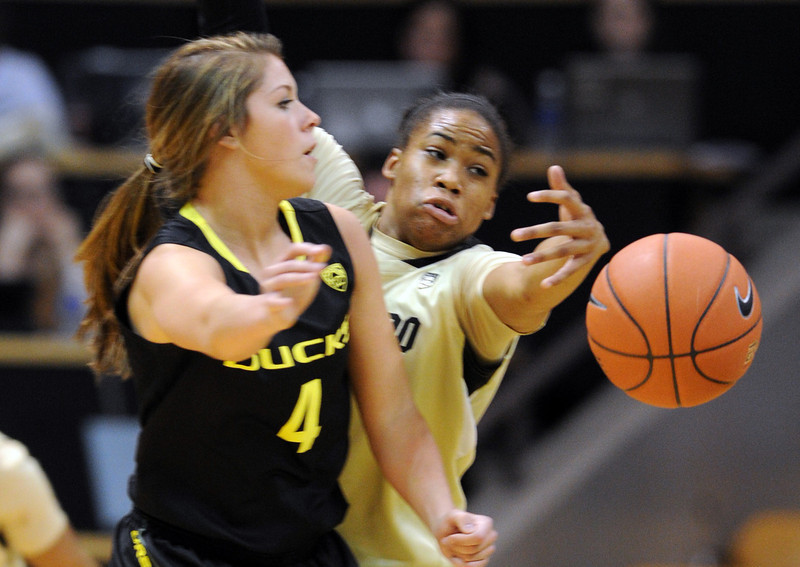 "Devyn Galland of Oregon gets the ball away as Brittany Wilson of CU defends.<br /> For more photos of the game, go to  <a href=""http://www.dailycamera.com"">http://www.dailycamera.com</a>.<br /> Cliff Grassmick / February 10, 2013"