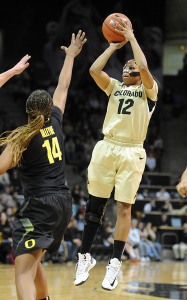 "Ashley Wilson of CU puts up a shot over Jillian Alleyne of Oregon.<br /> For more photos of the game, go to  <a href=""http://www.dailycamera.com"">http://www.dailycamera.com</a>.<br /> Cliff Grassmick / February 10, 2013"
