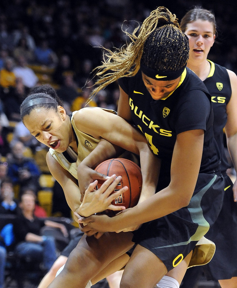 "Arielle Roberson of CU and Jillian Alleyne of Oregon, try to get possession.<br /> For more photos of the game, go to  <a href=""http://www.dailycamera.com"">http://www.dailycamera.com</a>.<br /> Cliff Grassmick / February 10, 2013"