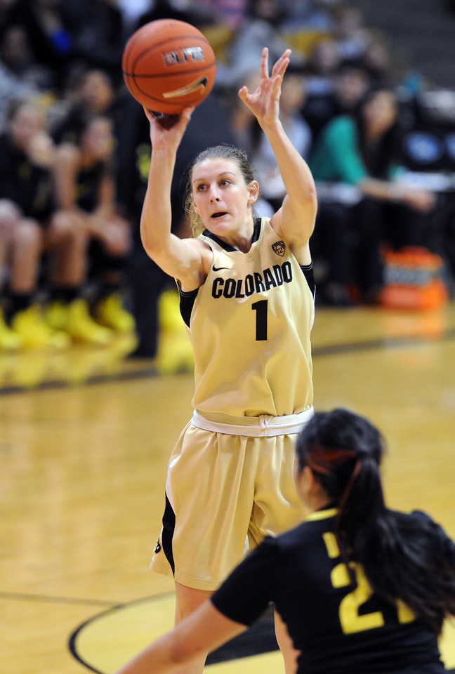 "Lexy Kresl of CU puts up a three on Oregon.<br /> For more photos of the game, go to  <a href=""http://www.dailycamera.com"">http://www.dailycamera.com</a>.<br /> Cliff Grassmick / February 10, 2013"