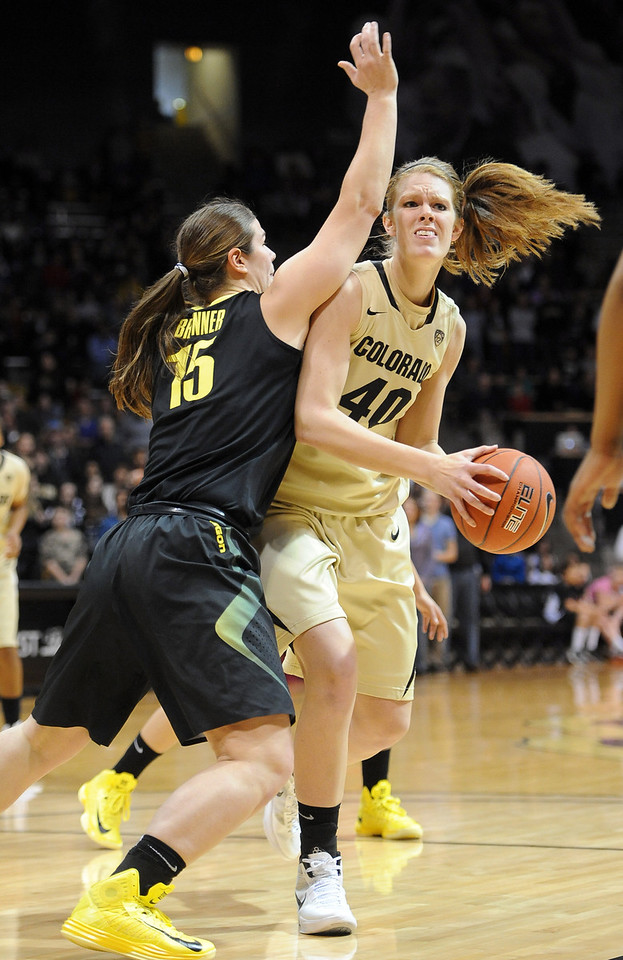 "Rachel Hargis of CU looks to shoot over Liz Brenner of Oregon.<br /> For more photos of the game, go to  <a href=""http://www.dailycamera.com"">http://www.dailycamera.com</a>.<br /> Cliff Grassmick / February 10, 2013"