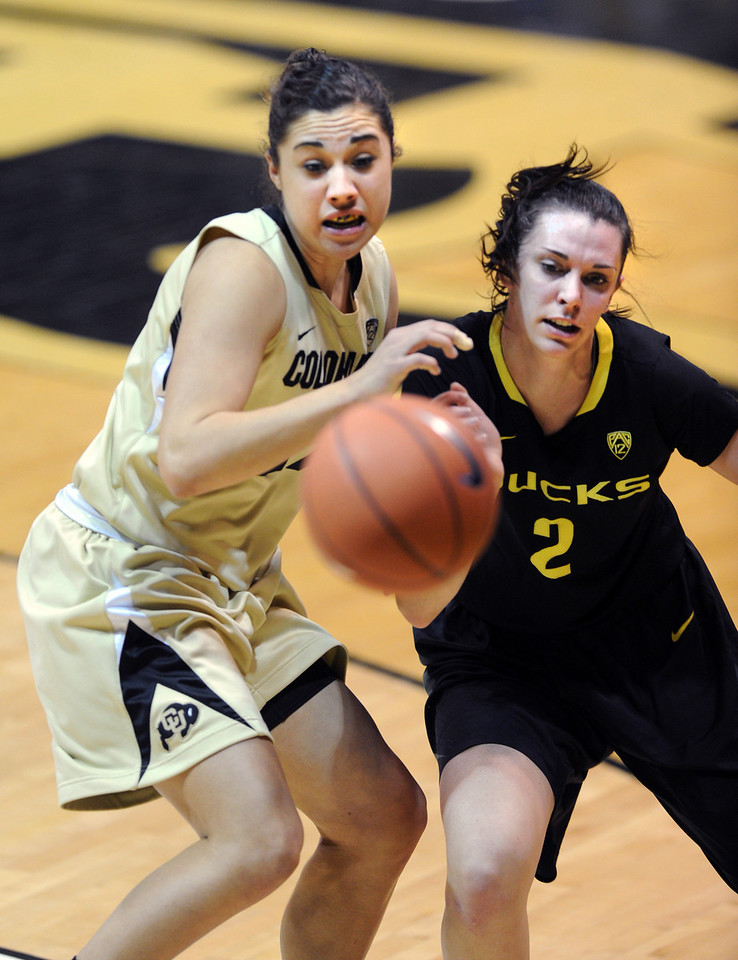 "Jasmine Sborov, left, of CU, and Danielle Love of Oregon, watch a ball go out of bounds.<br /> For more photos of the game, go to  <a href=""http://www.dailycamera.com"">http://www.dailycamera.com</a>.<br /> Cliff Grassmick / February 10, 2013"