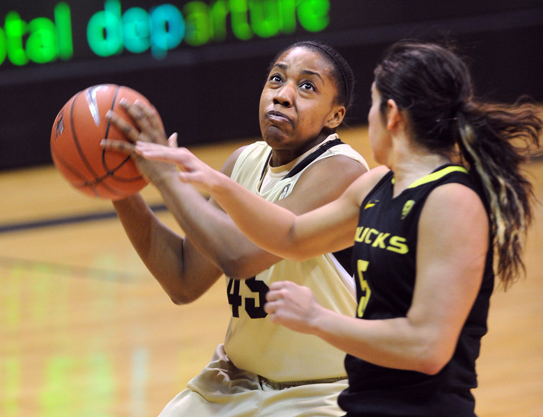 "Kyleesha Weston of CU goes to the basket on Jordan Loera of Oregon.<br /> For more photos of the game, go to  <a href=""http://www.dailycamera.com"">http://www.dailycamera.com</a>.<br /> Cliff Grassmick / February 10, 2013"