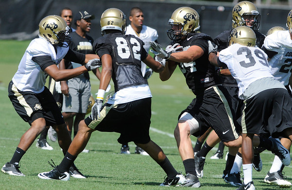 """Ryan Deehan, 34, runs in traffic during the University of Colorado Football team practice on Friday August 12, 2011.<br /> For more photos and video interviews from the practice go to  <a href=""""http://www.buffzone.com"""">http://www.buffzone.com</a> and dailycamera.com<br /> Photo by Paul Aiken  August 12,  2011."""