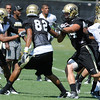 "Ryan Deehan, 34, runs in traffic during the University of Colorado Football team practice on Friday August 12, 2011.<br /> For more photos and video interviews from the practice go to  <a href=""http://www.buffzone.com"">http://www.buffzone.com</a> and dailycamera.com<br /> Photo by Paul Aiken  August 12,  2011."