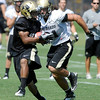 """Rodney Stewart, 5, makes a catch behind Jon Major, 31, during the University of Colorado Football team practice on Friday August 12, 2011.<br /> For more photos and video interviews from the practice go to  <a href=""""http://www.buffzone.com"""">http://www.buffzone.com</a> and dailycamera.com<br /> Photo by Paul Aiken  August 12,  2011."""