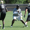"Coach Eric Bieniemy, lines us against Logan Gray, 2, and Paul Richardson, 6, during the University of Colorado Football team practice on Friday August 12, 2011.<br /> For more photos and video interviews from the practice go to  <a href=""http://www.buffzone.com"">http://www.buffzone.com</a> and dailycamera.com<br /> Photo by Paul Aiken  August 12,  2011."