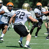 """Jonathan Hawkins, 18, zeros in on returner Arthur Jaffee, during special teams practice at the University of Colorado Football team practice on Friday August 12, 2011.<br /> For more photos and video interviews from the practice go to  <a href=""""http://www.buffzone.com"""">http://www.buffzone.com</a> and dailycamera.com<br /> Photo by Paul Aiken  August 12,  2011."""