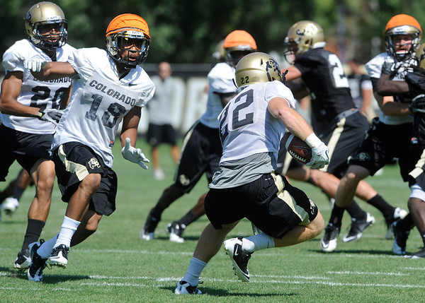 "Jonathan Hawkins, 18, zeros in on returner Arthur Jaffee, during special teams practice at the University of Colorado Football team practice on Friday August 12, 2011.<br /> For more photos and video interviews from the practice go to  <a href=""http://www.buffzone.com"">http://www.buffzone.com</a> and dailycamera.com<br /> Photo by Paul Aiken  August 12,  2011."