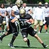 """Kyle Cefano, 35, moves downfield as Anthony Perkins, 7, avoids a hard collision during the University of Colorado Football team practice on Friday August 12, 2011.<br /> For more photos and video interviews from the practice go to  <a href=""""http://www.buffzone.com"""">http://www.buffzone.com</a> and dailycamera.com<br /> Photo by Paul Aiken  August 12,  2011."""