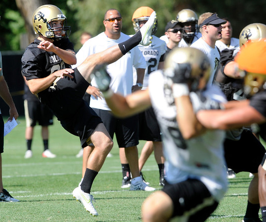 """Punter Darragh O'Neill, 90, during the University of Colorado Football team practice on Friday August 12, 2011.<br /> For more photos and video interviews from the practice go to  <a href=""""http://www.buffzone.com"""">http://www.buffzone.com</a> and dailycamera.com<br /> Photo by Paul Aiken  August 12,  2011."""